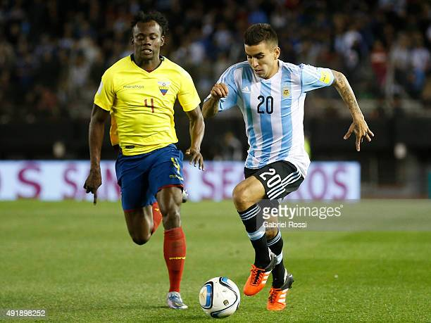 Angel Correa of Argentina fights for the ball with Frickson Erazo of Ecuador during a match between Argentina and Ecuador as part of FIFA 2018 World...