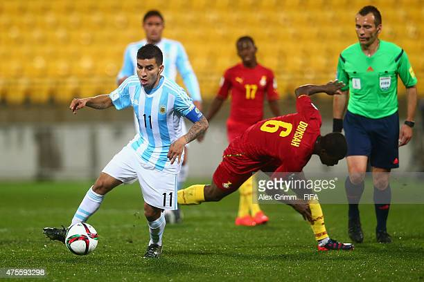 Angel Correa of Argentina is challenged by Godfred Donsah of Ghana during the FIFA U20 World Cup New Zealand 2015 Group B match between Argentina and...