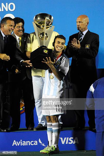 Angel Correa of Argentina lifts the trophy after winning the title at the end of the match between Argentina and Uruguay as part of South American...