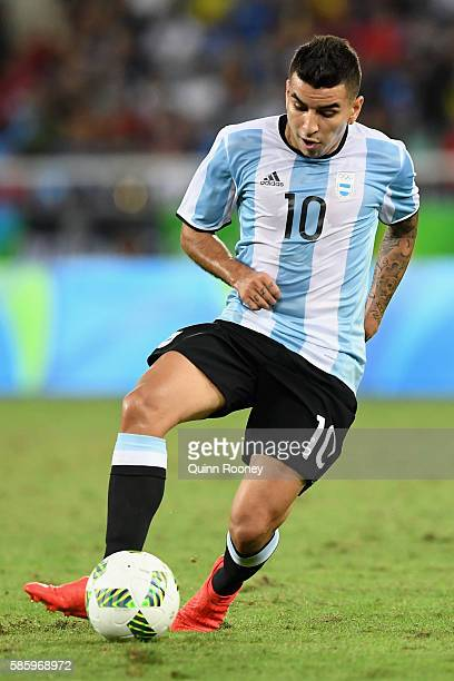Angel Correa of Argentina runs with the ball during the Men's Group D first round match between Portugal and Argentina during the Rio 2016 Olympic...