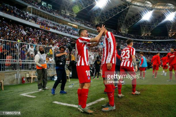 Angel Correa of Athletico Madrid celebrates scoring their third goal during the Supercopa de Espana SemiFinal match between FC Barcelona and Club...