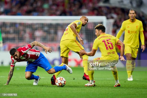 Angel Correa of Atletico de Madrid battle for the ball with Alex Oxlade-Chamberlain of Liverpool FC during the UEFA Champions League group B match...