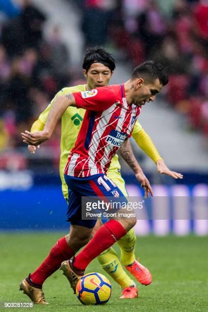 Angel Correa of Atletico de Madrid battles for the ball with Gaku Shibasaki of Getafe CF during the La Liga 201718 match between Atletico de Madrid...
