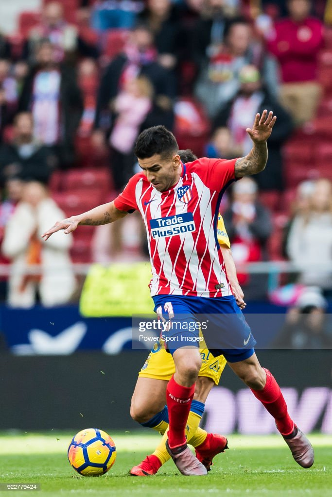 Angel Correa (L) of Atletico de Madrid battles for the ball with Jairo Samperio Bustara of UD Las Palmas during the La Liga 2017-18 match between Atletico de Madrid and UD Las Palmas at Wanda Metropolitano on January 28 2018 in Madrid, Spain.