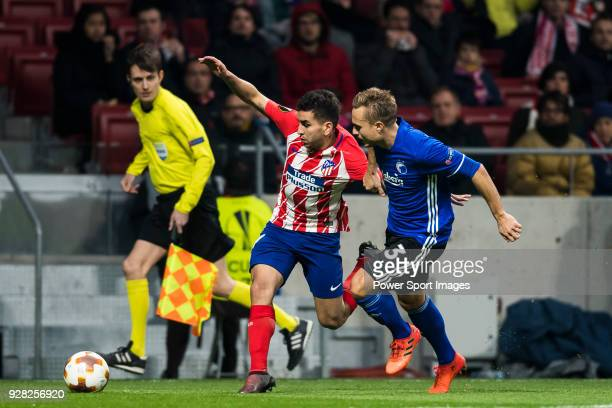 Angel Correa of Atletico de Madrid battles for the ball with Pierre Bengtsson of FC Copenhague during the UEFA Europa League 201718 Round of 32 match...