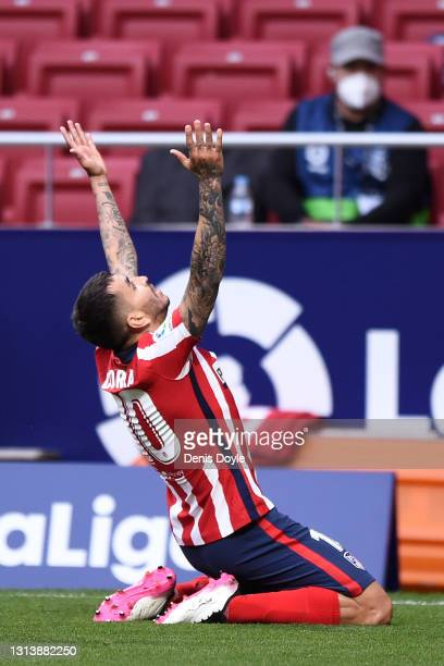Angel Correa of Atletico de Madrid celebrates after scoring their sides first goal during the La Liga Santander match between Atletico de Madrid and...