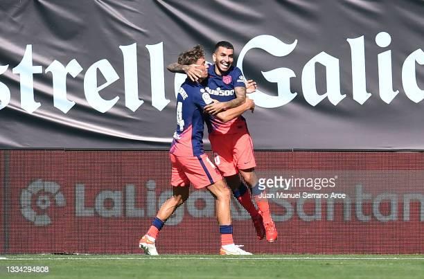 Angel Correa of Atletico de Madrid celebrates after scoring their side's first goal during the LaLiga Santander match between RC Celta de Vigo and...