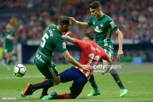 Angel Correa of Atletico de Madrid fight with Amat of Betis during a match between Atletico de Madrid vs Betis for La Liga Española at Wanda...
