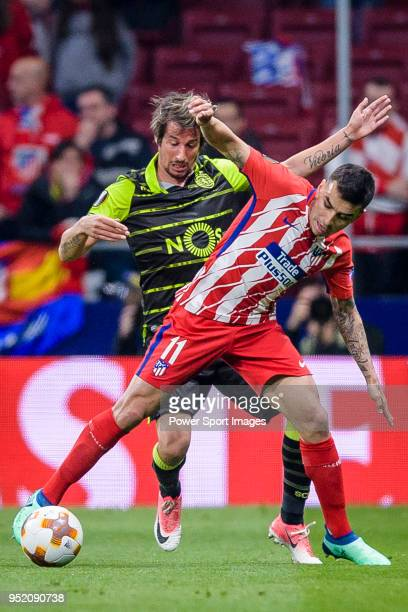 Angel Correa of Atletico de Madrid fights for the ball with Fabio Coentrao of Sporting CP during the UEFA Europa League quarter final leg one match...