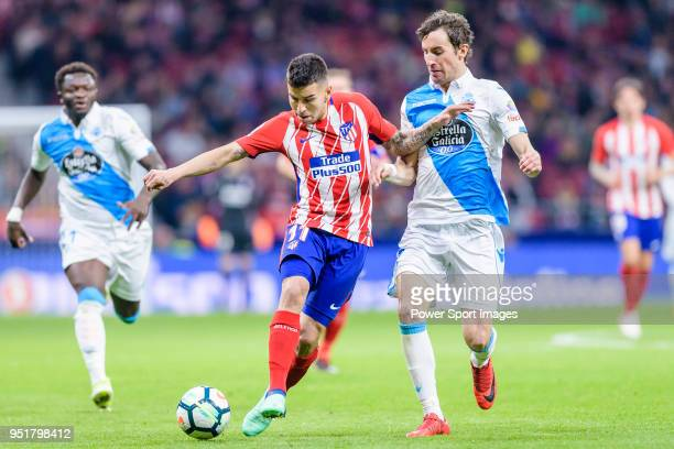 Angel Correa of Atletico de Madrid fights for the ball with Pedro Mosquera Parada of Deportivo La Coruna in action during the La Liga 201718 match...