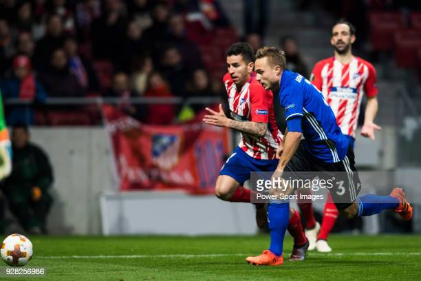 Angel Correa of Atletico de Madrid fights for the ball with Pierre Bengtsson of FC Copenhague during the UEFA Europa League 201718 Round of 32 match...