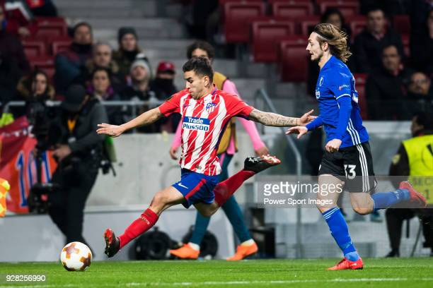 Angel Correa of Atletico de Madrid is followed by Rasmus Falk of FC Copenhague during the UEFA Europa League 201718 Round of 32 match between...