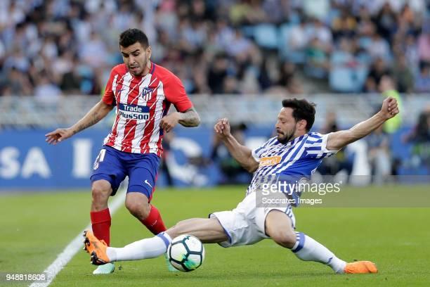 Angel Correa of Atletico Madrid Alberto de la Bella of Real Sociedad during the La Liga Santander match between Real Sociedad v Atletico Madrid at...
