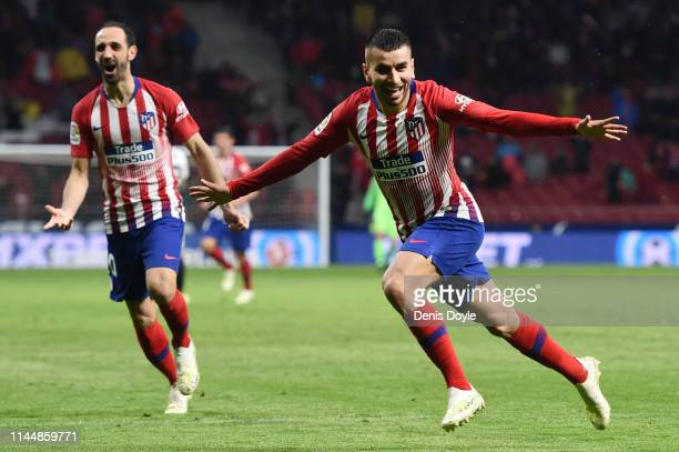 Angel Correa of Atletico Madrid celebrates after scoring his team's third goal during the La Liga match between Club Atletico de Madrid and Valencia...