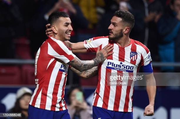 Angel Correa of Atletico Madrid celebrates with teammate Koke after scoring his team's first goal during the Liga match between Club Atletico de...