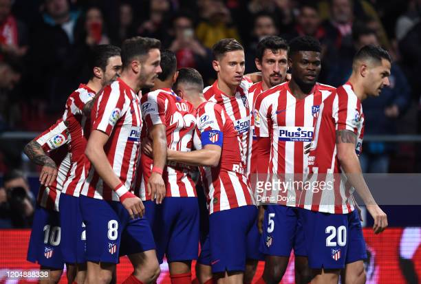 Angel Correa of Atletico Madrid celebrates with teammates after scoring his team's first goal during the Liga match between Club Atletico de Madrid...