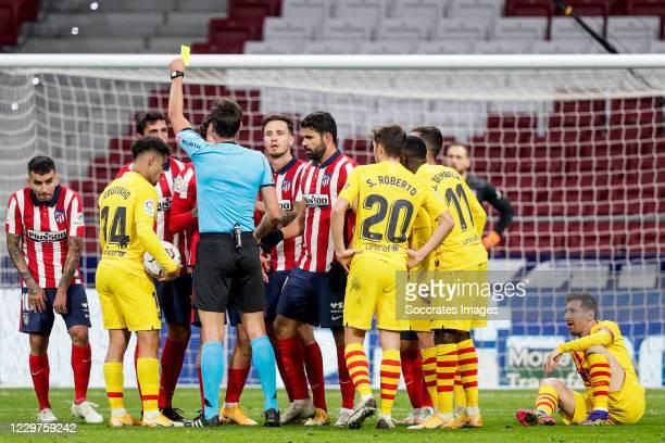 Angel Correa of Atletico Madrid, Coutinho of FC Barcelona, Stefan Savic of Atletico Madrid, Jose Maria Gimenez of Atletico Madrid, referee Jose Luis...