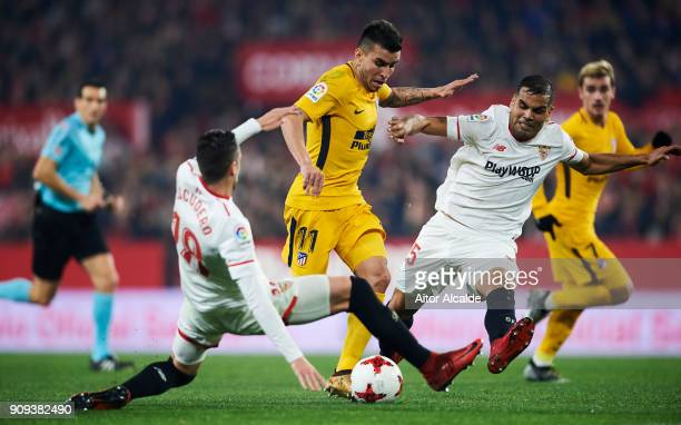 Angel Correa of Atletico Madrid duels for the ball with Gabriel Mercado of Sevilla FC during the Copa del Rey Quarter Final second Leg match between...