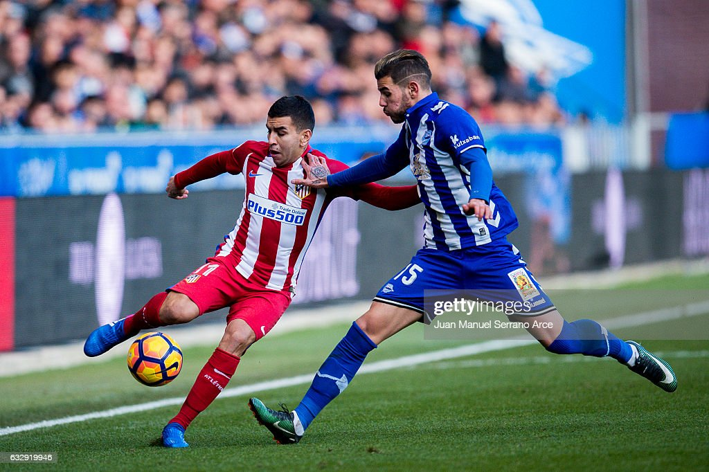 Angel Correa of Atletico Madrid duels for the ball with Theo Hernandez of Deportivo Alaves during the La Liga match between Deportivo Alaves and Atletico Madrid at Mendizorroza stadium on January 28, 2017 in Vitoria-Gasteiz, Spain.