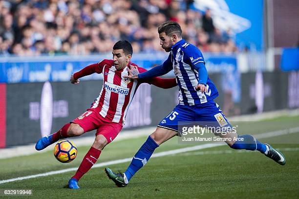 Angel Correa of Atletico Madrid duels for the ball with Theo Hernandez of Deportivo Alaves during the La Liga match between Deportivo Alaves and...