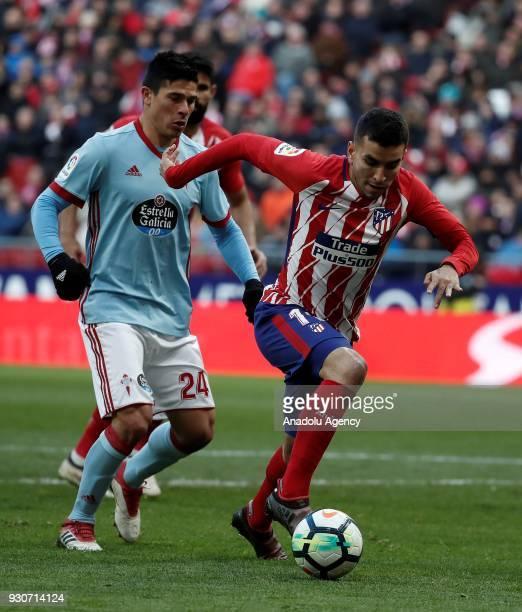 Angel Correa of Atletico Madrid in action against Facundo Roncaglia of Celta Vigo during the La Liga soccer match between Atletico Madrid and Celta...