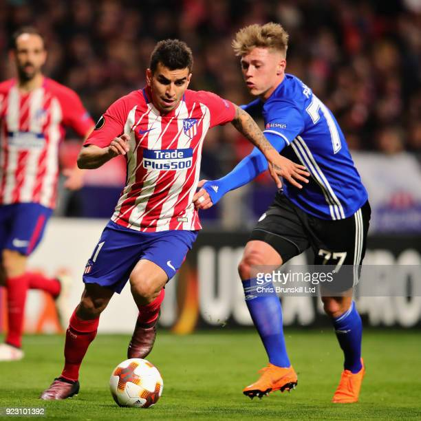 Angel Correa of Atletico Madrid is challenged by Viktor Fischer of FC Copenhagen during the UEFA Europa League Round of 32 match between Atletico...