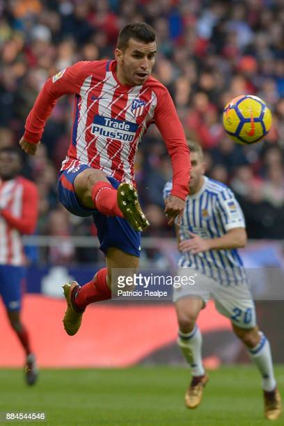 Angel Correa of Atletico Madrid jumps to control the ball during a match between Atletico Madrid and Real Sociedad as part of La Liga at Wanda...