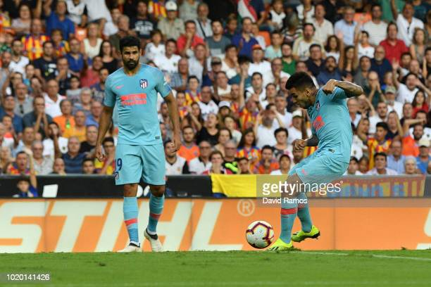 Angel Correa of Atletico Madrid scores his team's first goal during the La Liga match between Valencia CF and Club Atletico de Madrid at Estadio...