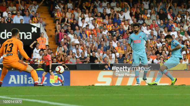 Angel Correa of Atletico Madrid scores his team's first goal past Norberto Murara Neto of Valencia during the La Liga match between Valencia CF and...