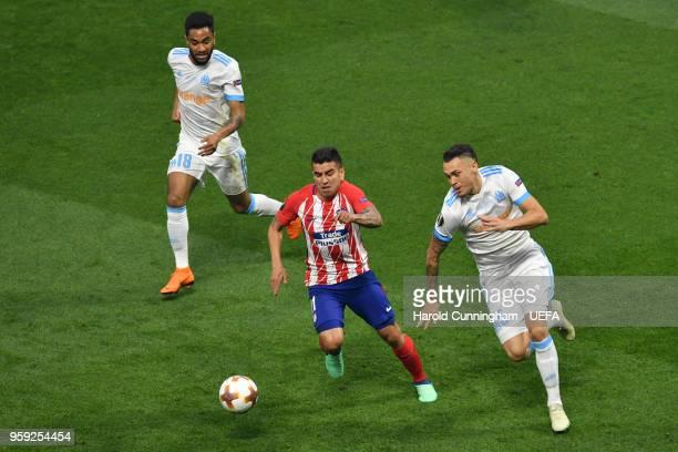 Angel Correa of Atletico Madrid takes on Jordan Amavi and Lucas Ocampos of Marseille during the UEFA Europa League Final between Olympique de...