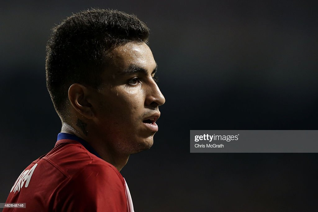 Angel Correa #16 of Atletico Madrid watches on against Sagan Tosu F.C. during the friendly match between Atletico Madrid and Sagan Tosu F.C. at Tosu Stadium on August 1, 2015 in Tosu, Japan.