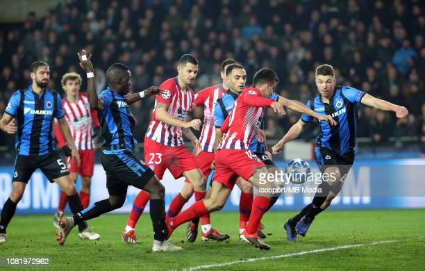 Angel Correa of Atletico Sofyan Amrabat of Club Brugge and Brandon Mechele of Club Brugge fight for the ball during the UEFA Champions League Group A...