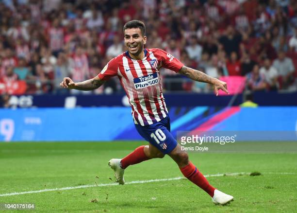 Angel Correa of Club Atletico de Madrid celebrates after scoring his teams third goal during the La Liga match between Club Atletico de Madrid and SD...