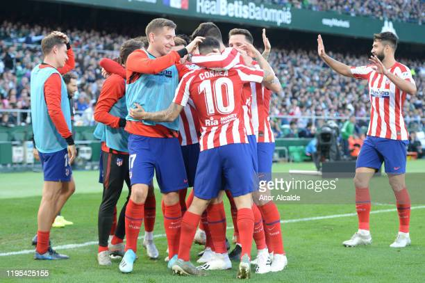 Angel Correa of Club Atletico de Madrid celebrates after scoring his sides first goal with teammates during the Liga match between Real Betis...
