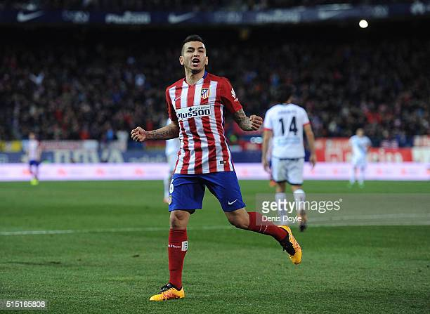 Angel Correa of Club Atletico de Madrid celebrates after scoring his team's 3rd goal during the La Liga match between Club Atletico de Madrid and RC...