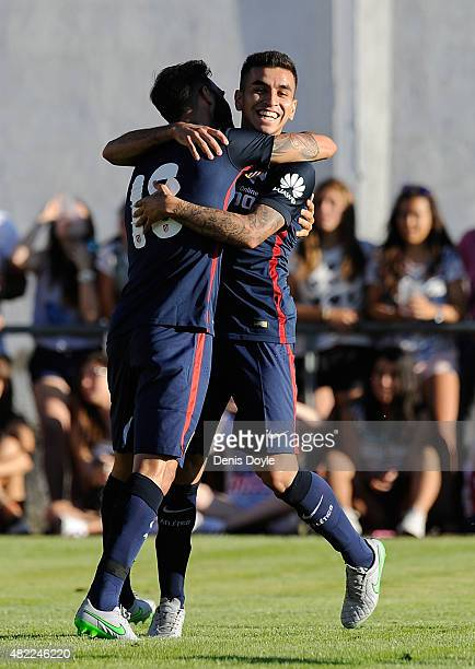 Angel Correa of Club Atletico de Madrid celebrates with Jesus Gamez after scoring his team's 2nd goal during the Jesus Gil y Gil Memorial preseason...