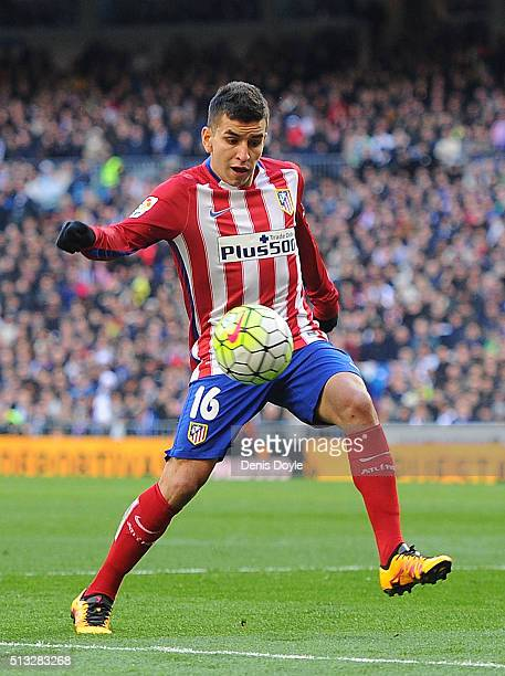 Angel Correa of Club Atletico de Madrid in action during the La Liga match between Real Madrid CF and Club Atletico de Madrid at Estadio Santiago...