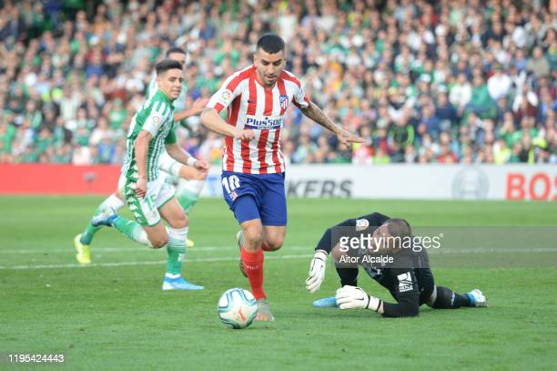 Angel Correa of Club Atletico de Madrid scores his sides first goal during the Liga match between Real Betis Balompie and Club Atletico de Madrid at...