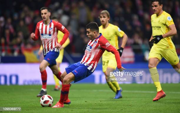 Angel Correa of Club Atletico de Madrid scores to make it 22 during the Copa del Rey Round of 16 match between Atletico Madrid and Girona at Wanda...