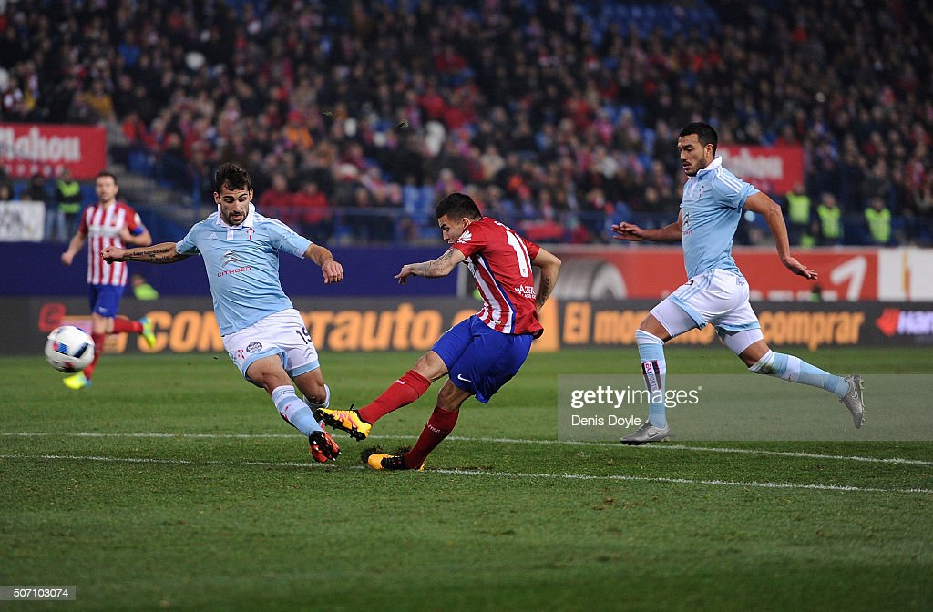 Angel Correa of Club Atletico de Madrid shoots past Jonny Castro Otto of Celta Vigo during the Copa del Rey Quarter Final 2nd Leg match between Club Atletico de Madrid and Celta Vigo at Vicente Calderon Stadium on January 27, 2016 in Madrid, Spain.