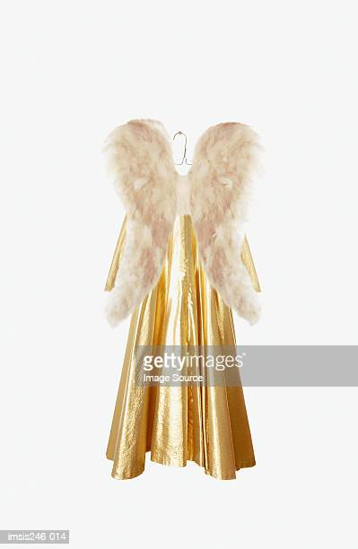 angel costume on hanger - gold dress stock pictures, royalty-free photos & images