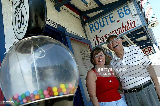 Angel Delgadillo and his daughter Mirna stand outside their souvenir shop on Route 66 in Seligman AZ 12 July 2003 Delgadillo recalls how 'the world...