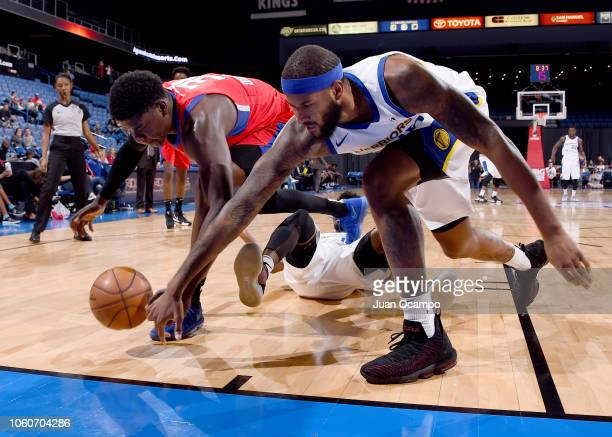 Angel Delgado of the Agua Caliente Clippers of Ontario battles for the loose ball against Jaleel Cousins of the Santa Cruz Warriors on November 9...