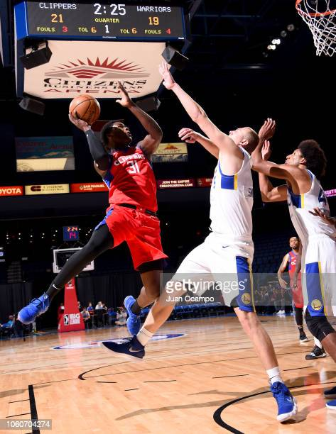 Angel Delgado of the Agua Caliente Clippers of Ontario drives to the basket against Alen Smailagic of the Santa Cruz Warriors on November 9 2018 at...
