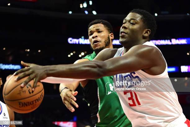 Angel Delgado of the Los Angeles Clippers and Kennedy Meeks of Maccabi Haifa for for a rebound in the second half of the game at Staples Center on...