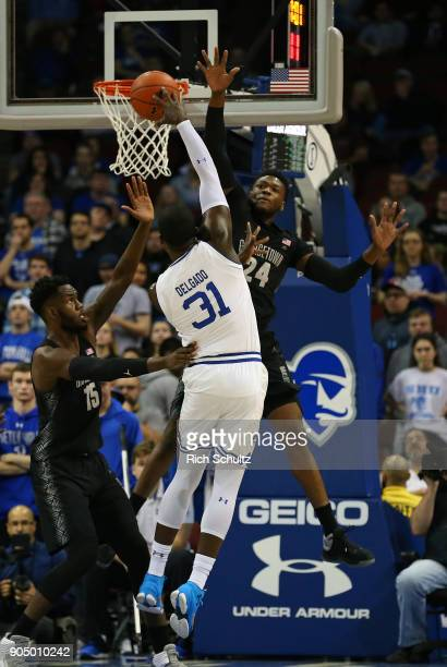 Angel Delgado of the Seton Hall Pirates attempts a shot Marcus Derrickson of the Georgetown Hoyas defends during the first half of a game at...