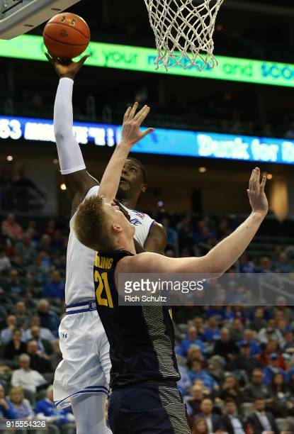 Angel Delgado of the Seton Hall Pirates attempts a shot over Harry Froling of the Marquette Golden Eagles during the second half of a game at...