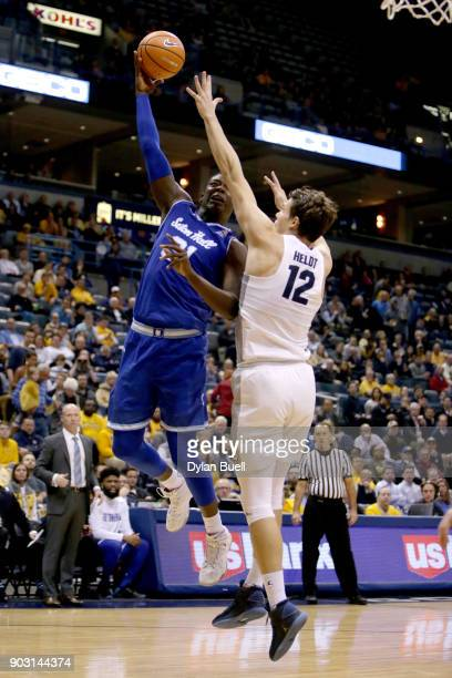Angel Delgado of the Seton Hall Pirates attempts a shot while being guarded by Matt Heldt of the Marquette Golden Eagles in the second half at the...