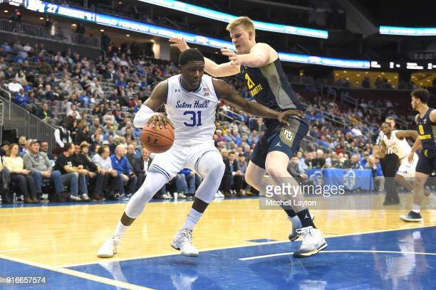 Angel Delgado of the Seton Hall Pirates dribbles the ball around Harry Froling of the Marquette Golden Eagles during a college basketball game at the...