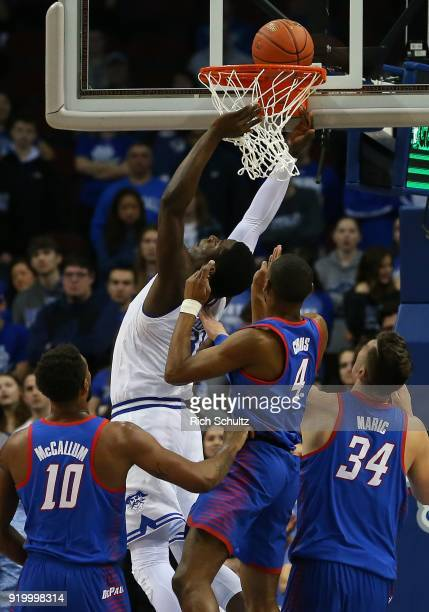 Angel Delgado of the Seton Hall Pirates dunks in front of Tre'Darius McCallum Brandon Cyrus and Marin Maric of the DePaul Blue Demons during the...